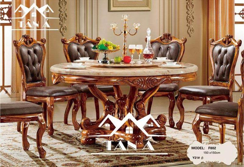 Bộ bàn ăn tròn mặt đá xoay 8 ghế gỗ sồi bọc nệm